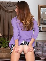 Vanessa Bush enjoys stripping off a purple shirt