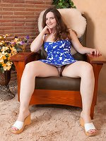 Snow strips naked in her armchair